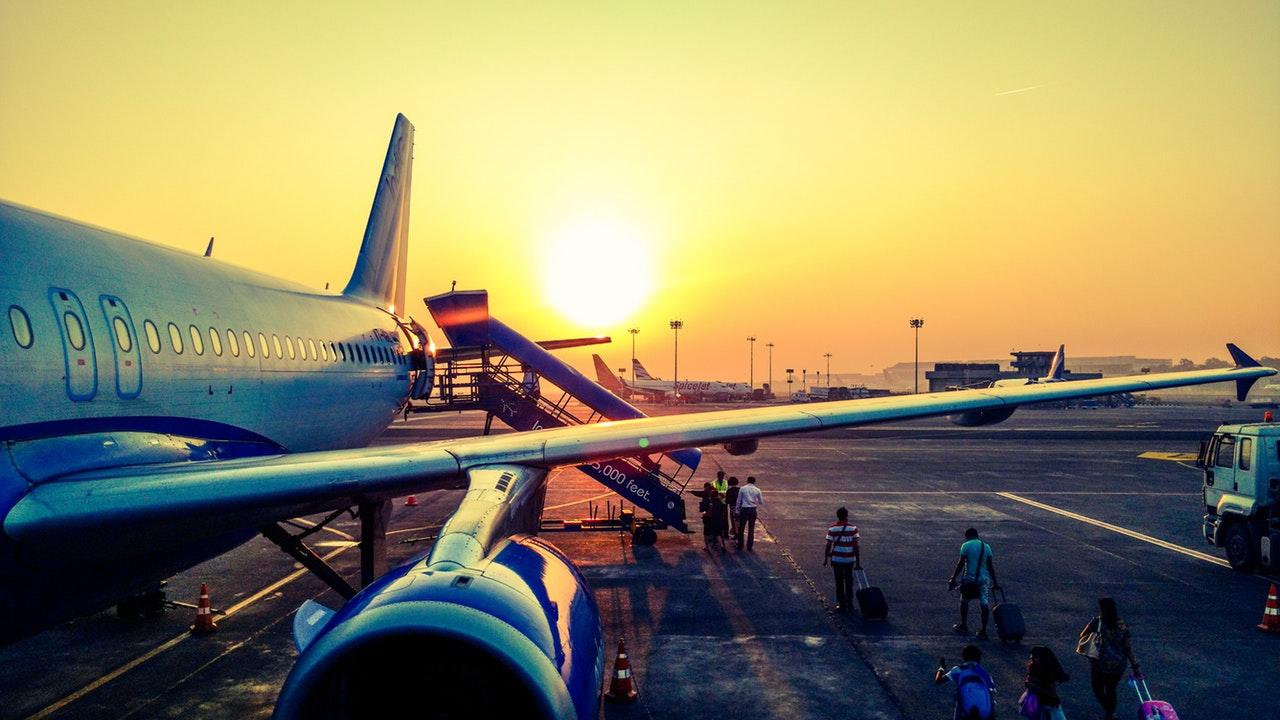 Passengers boarding large jet plane