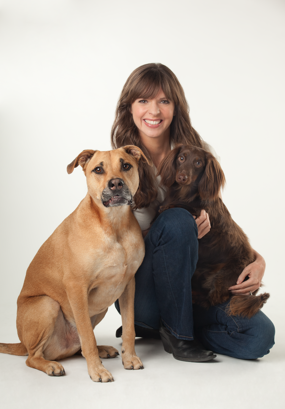 brown haired woman with two dogs