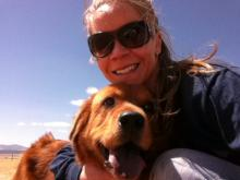 Katie Parker, board member, with her golden retriever