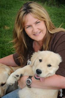 Jenny Kachnic, President, with her Golden Retriever puppy